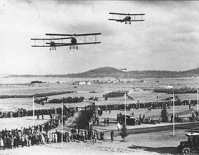 Air Force and civilian aircraft fly over the royal entourage at the opening in 1927.