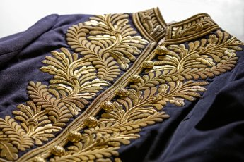 Detail of Sir Edmund Barton's coatee. In 1902 he wore this gold-embroidered wool uniform at the coronation of King Edward VII in London. Museum of Australian Democracy Collection.