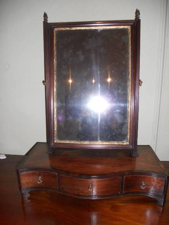 Rare early serpentine 18th C mirror