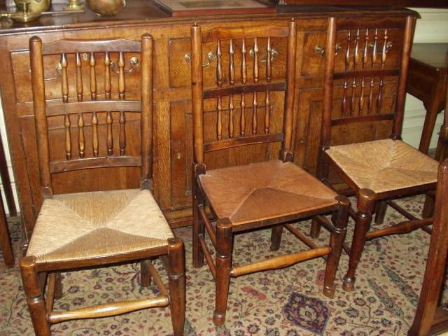 Spindle-back, rush-seated  chairs