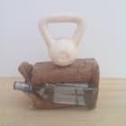 Cassie Raihl, HEAVY SIPS, 2013, tequila bottle, brown paper bag, wax, plaster, 15 × 12 × 4 in.