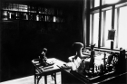 Untitled (View of Study Room with Books, Desk and Windows)