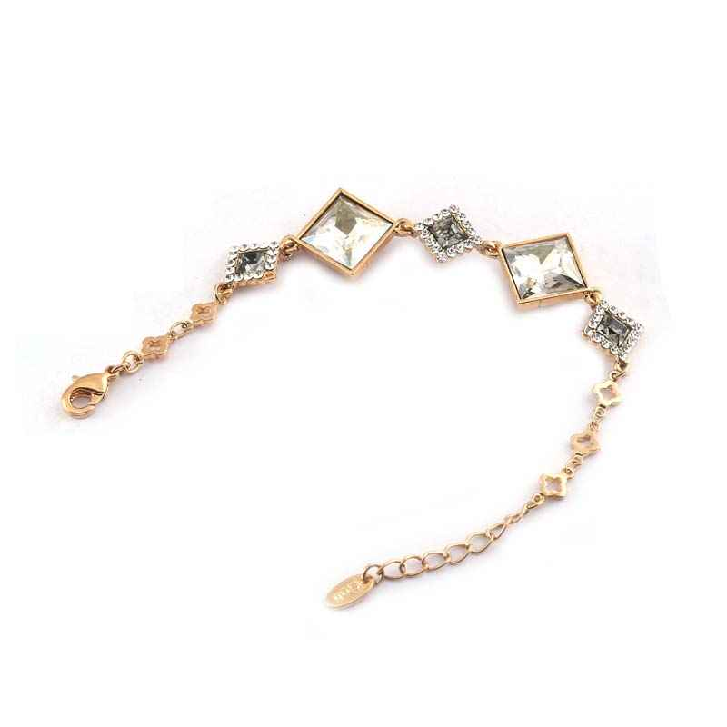 Diamond shaped design gold plated bracelet made with elements from Swarovski.