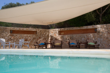 Large terrace around the pool in the shade sail
