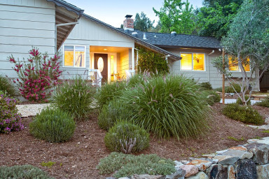 Attractive landscaping and beautiful rock enhance the front yard.