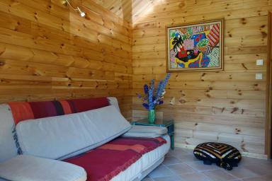 Salon TV avec canapé-lit