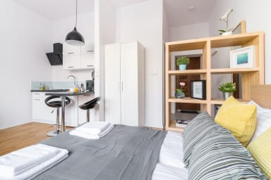 A bright, modern studio apartment, prepared both for reciving a couple coming...