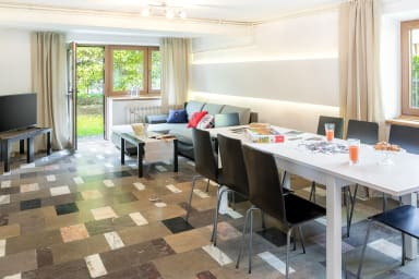 Spacious living-dining room with access to the garden.