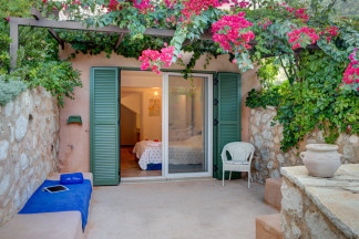Enjoy the outdoor privacy and the fragrance of the flowers all around