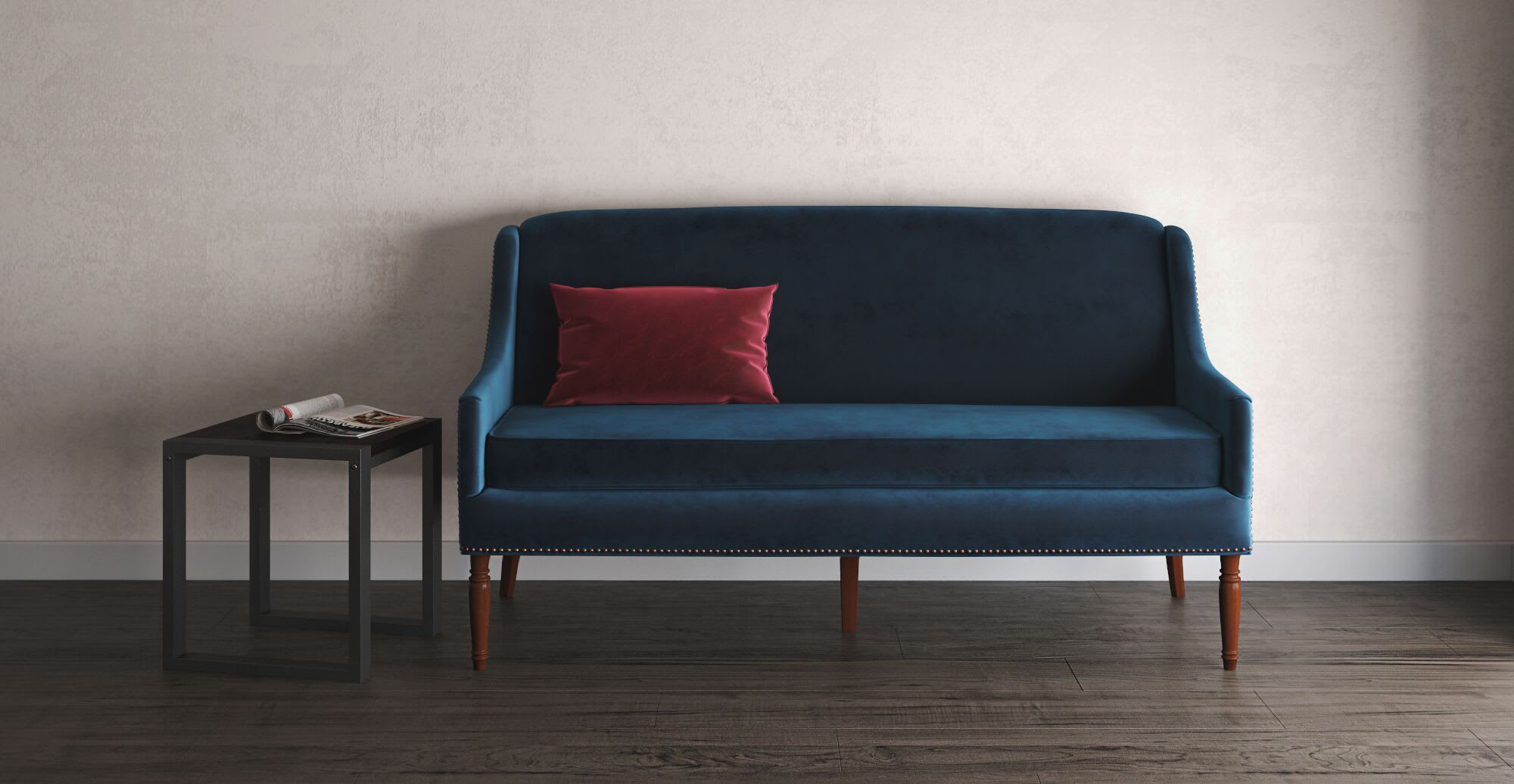 A red throw pillow on a blue sofa