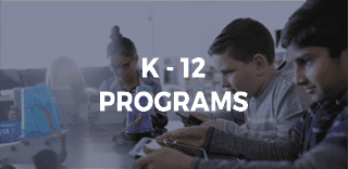 K-12 PROGRAMS on background of hildren concentrating on iPad and robots