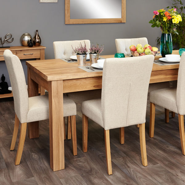 Mobel Oak extending table and 6 cream flock chairs