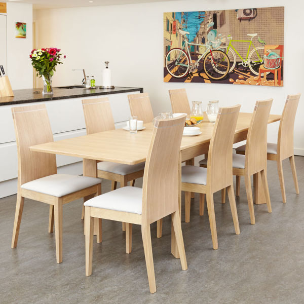 Olten Oak Light eight seat extending dining table with eight cream chairs