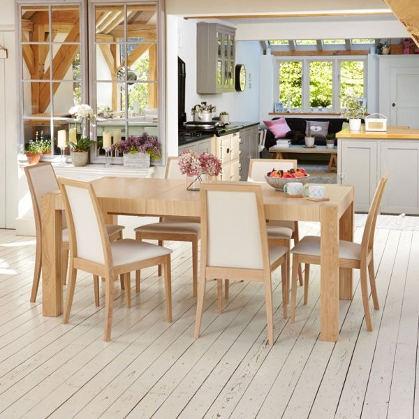 Olten Oak extending table and six cream chairs