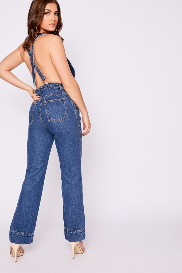 1f16de795e0 ALYSI MID WASH DENIM HALTERNECK JUMPSUIT. 1