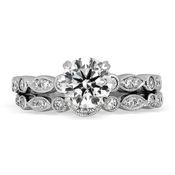 แหวนทอง 18K ประดับเพชร น้ำหนักรวม 0.62 กะรัต ค่าสี D ค่าความสะอาด VVS1 EX/EX/EX เพชรมาพร้อมใบรับรองจากสถาบัน GIA และแหวนเพชร Matching Band