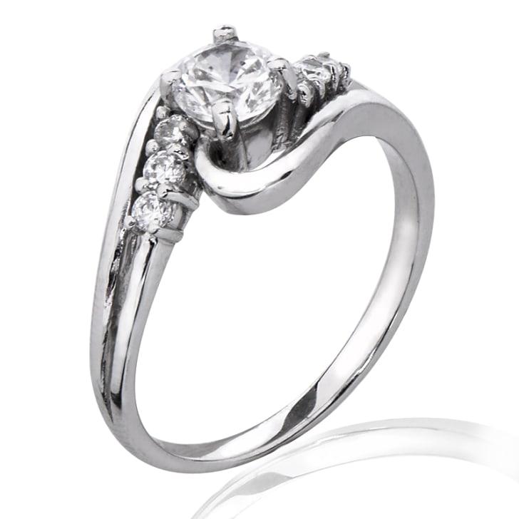 แหวนทอง 18K ประดับเพชร น้ำหนักรวม 0.70 กะรัต ค่าสี F ค่าความสะอาด VS2 EX/EX/EX เพชรมาพร้อมใบรับรองจาก GIA