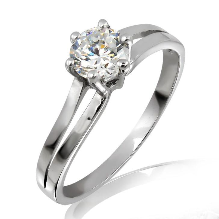 แหวนทอง 18K ประดับเพชร น้ำหนักรวม 0.50 กะรัต ค่าสี F ค่าความสะอาด VS2 EX/EX/EX เพชรมาพร้อมใบรับรองจาก GIA