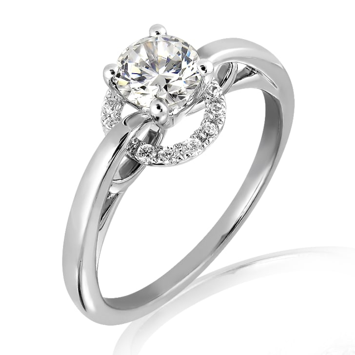 แหวนทอง 18K ประดับเพชร น้ำหนักรวม 0.30 กะรัต ค่าสี E ค่าความสะอาด VS