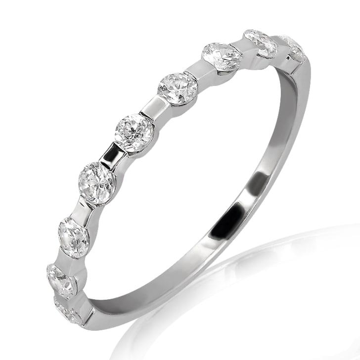 แหวนทอง 18K ประดับเพชร น้ำหนักรวม 0.20 กะรัต ค่าสี F ค่าความสะอาด VS2
