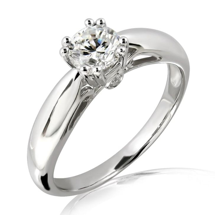 แหวนทอง 18K ประดับเพชร น้ำหนักรวม 0.77 กะรัต ค่าสี F (น้ำ 98) ค่าความสะอาด VVS2 เพชรมาพร้อมใบรับรองจากสถาบัน IGL