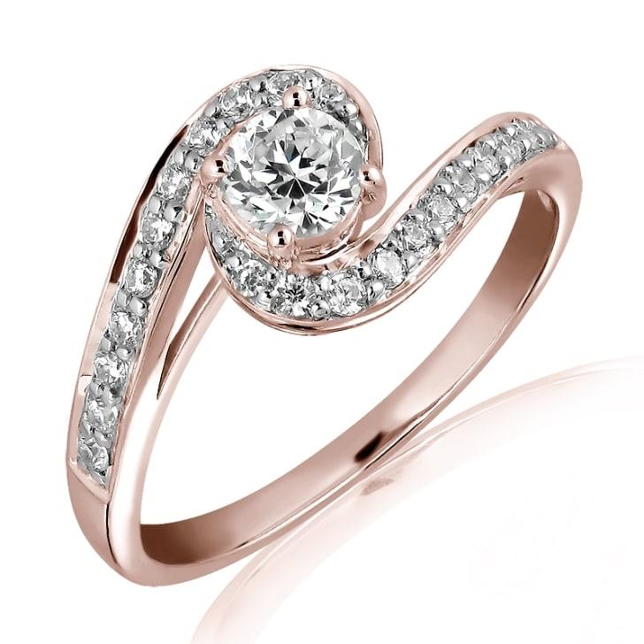 แหวนทอง 18K Rose Gold ประดับเพชร น้ำหนักรวม 0.50 กะรัต ค่าสี E ค่าความสะอาด VS1