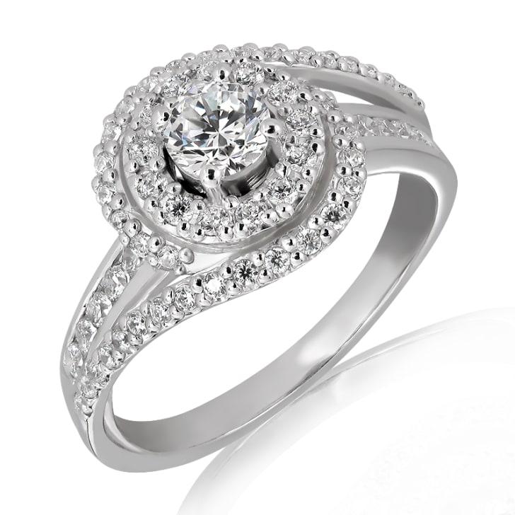 แหวนทอง 18K ประดับเพชร น้ำหนักรวม 0.75  กะรัต ค่าสี E  ค่าความสะอาด VS1