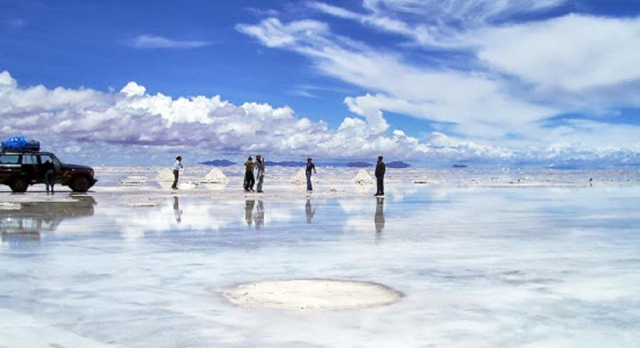 Bolivia -  Uyuni-Salt flats in rain with car