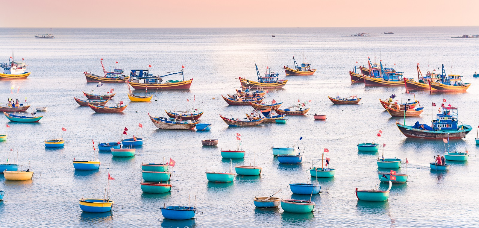 Colorful fishing boat float on the sea at town port in Mui Ne, Vietnam