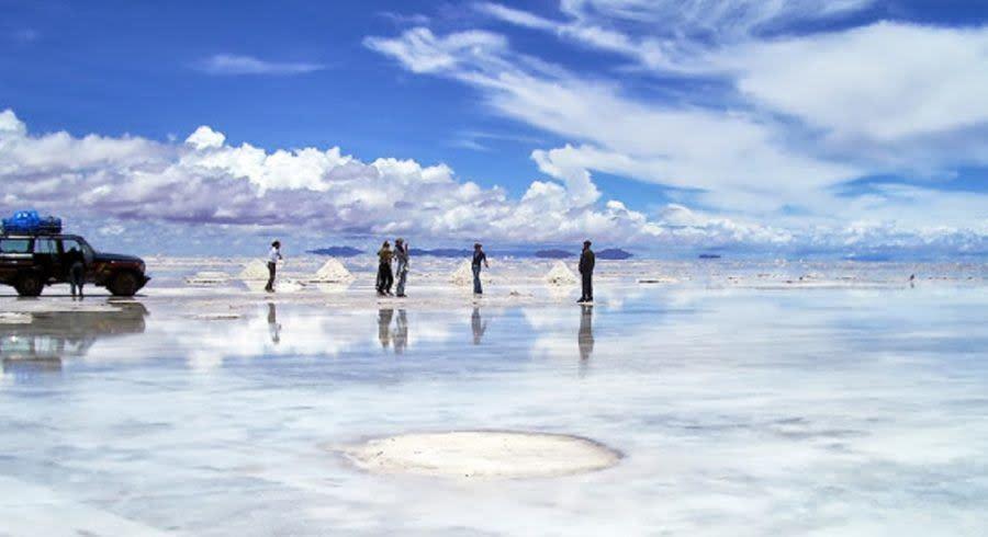 Bolivia -  Uyuni-Salt flats in rain with car
