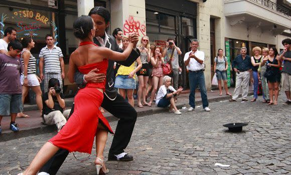 pair of tango dancers perform in San Telmo in Buenos Aires, Argentina, South America