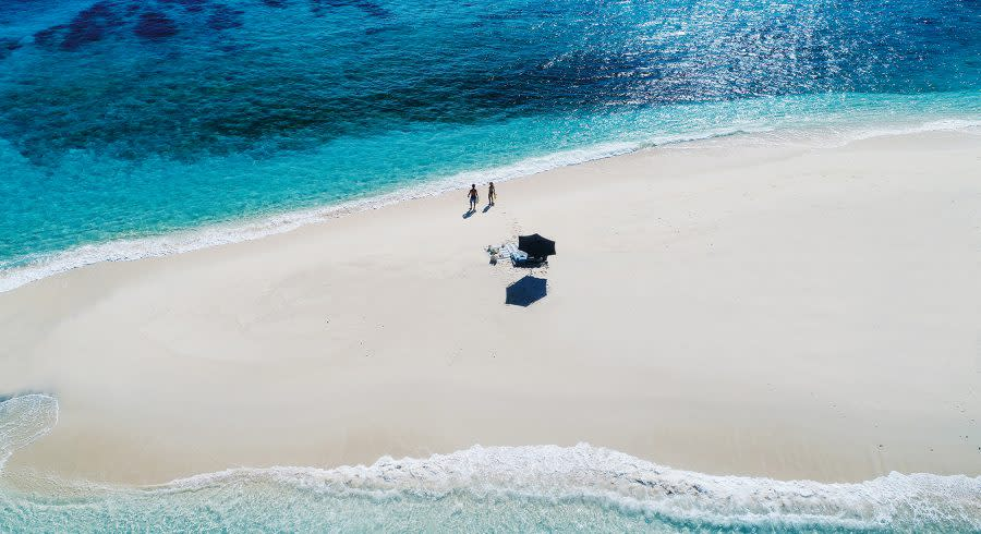 Fiji - people walking on a beach