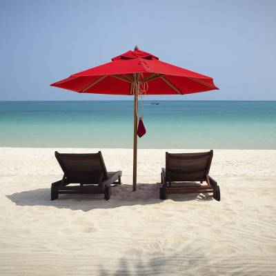 an umbrella sitting on top of a beach