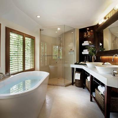 a room with a large tub next to a window