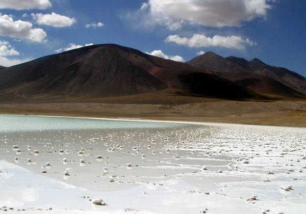 a beach with Laguna Verde in the background