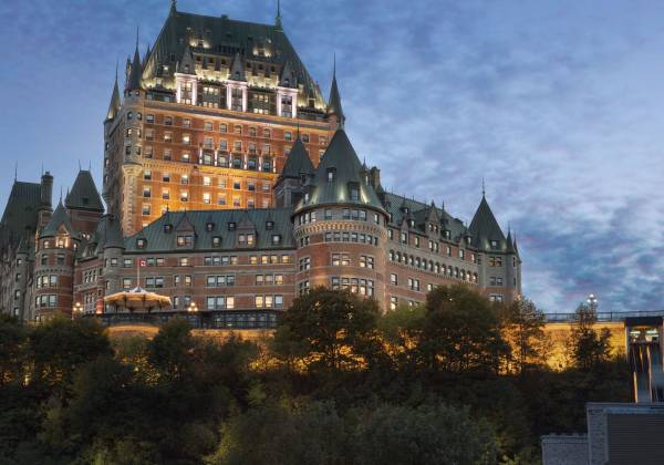 a castle with a clock at the top of Château Frontenac