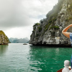 Traveler on a cruise in the Halong Bay of Vietnam