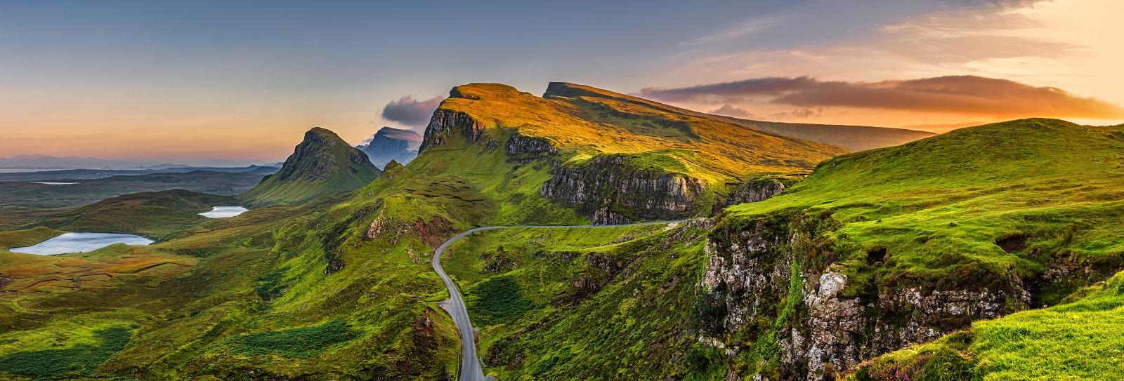 Panorama of Quiraing mountains sunset at Isle of Skye, Scottish highlands, United Kingdom