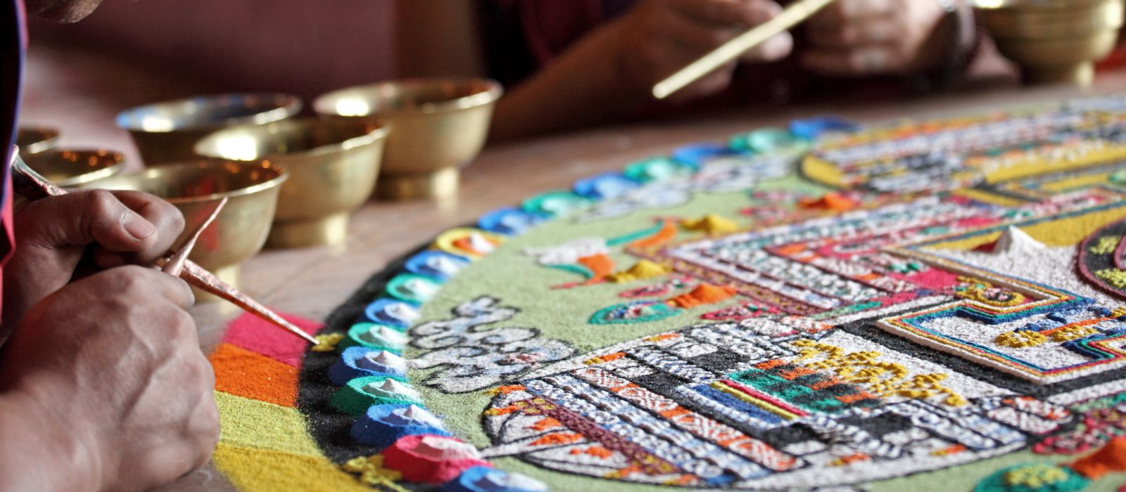 Buddhist monks making sand mandala in Diskit gompa at Nubra valley
