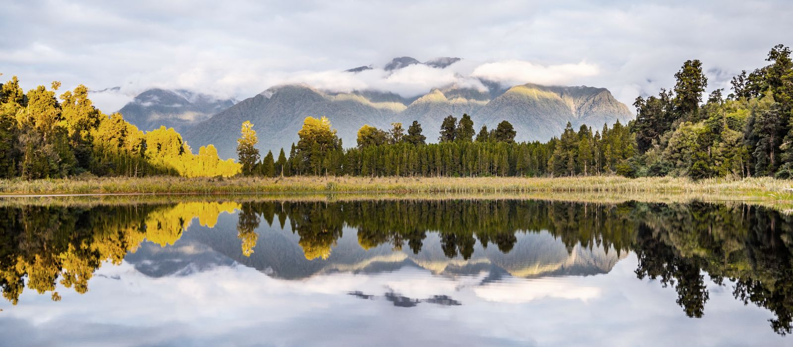 Enchanting Travels New Zealand Tours Lake Brunner and mountains