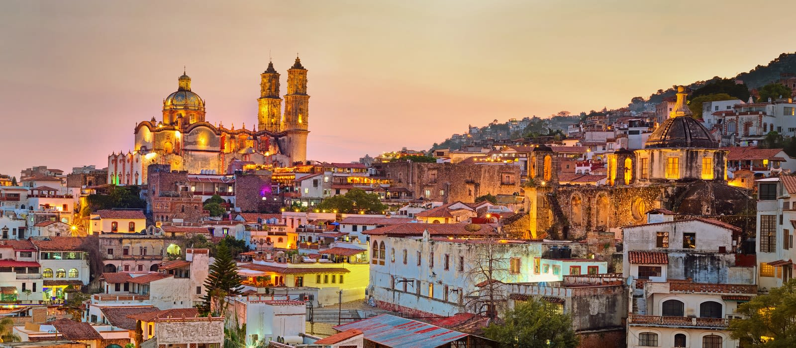 Enchanting Travels Mexico Tours Panorama of Taxco city at sunset in Mexico - things to do in Mexico - Mexico holiday