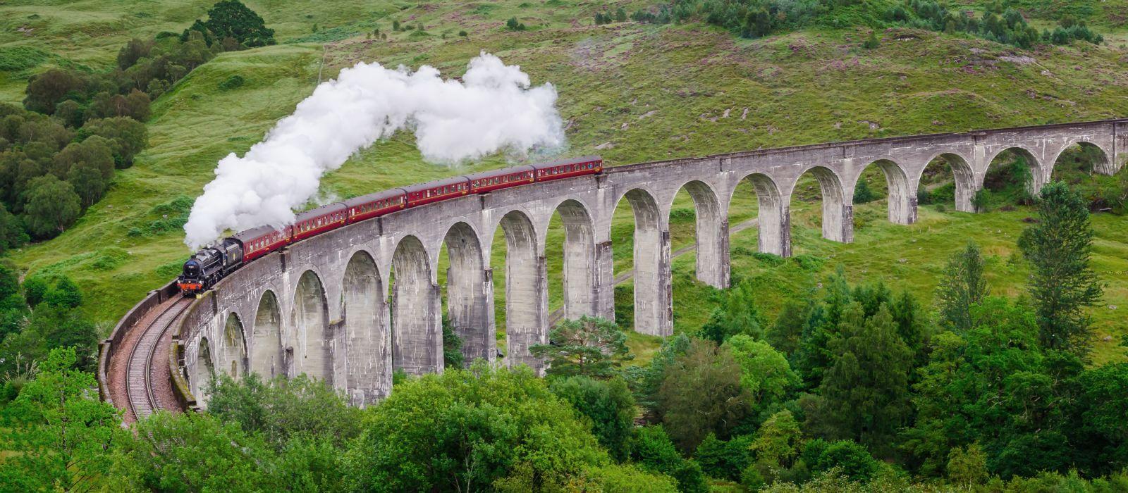 Jacobite steam train on Glenfinnan Viaduct approaching, Highlands, Scotland, United Kingdom, Europe