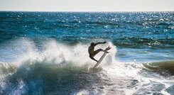 Man surfing on the beach, Chile
