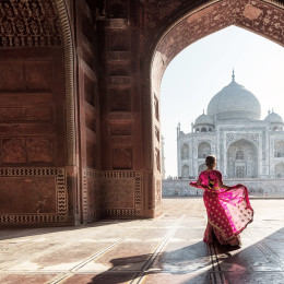 Lady standing near Taj Mahal, Agra, India - Best Time to Visit India