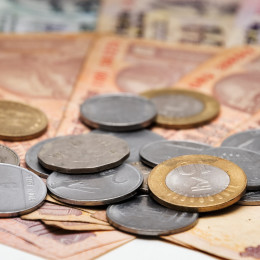 Indian Currency different Rupee bank notes and coins background