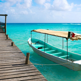 Enchanting Travels Mexico Tours Caribbean beach pier in Costa Maya of Mayan Mexico