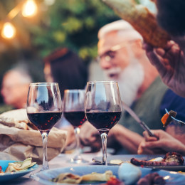 Australia Tours family eating and drinking red wine at dinner barbecue party outdoor