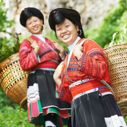Enchanting Travels China Tours Group of happy chinese minority woman Yao in traditional dresses outdoors - China travel guide