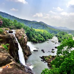 Witness the thundering Athirapally Waterfalls of Kerala during the monsoon season