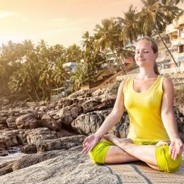 North India travel guide Enchanting Travels India Tours Woman doing yoga meditation, Kovalam, Kerala, India, Asia,